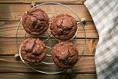 top view of chocolate muffins on wooden table