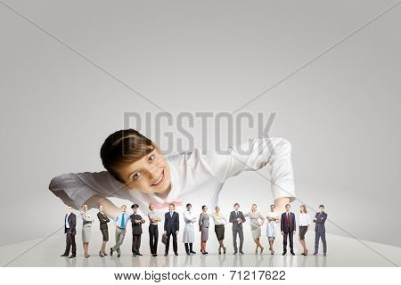 Businesswoman leaning on table and looking at businessteam
