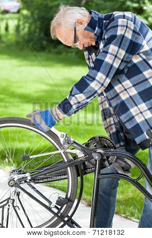 Man In Glasses Repaired Pedals A Bicycle