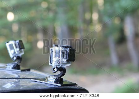 Gopro Hero 3 Cameras On The Hood Of A Car In Nature. Gopro Went Public June 26 2014 On The Nyse As S
