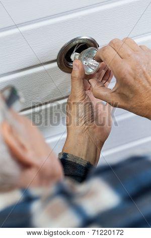 Man Repairing A Halogen