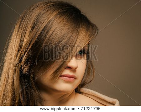 Portrait Of Pretty Girl With Hair Fringe Covered Eye