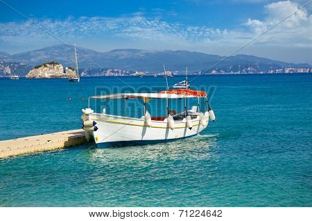Boat for tourists on Valtos beach near Parga town of Syvota area in Greece.