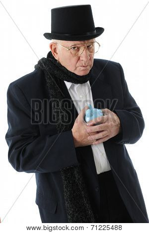 A miserly Scrooge glaring at the viewer while clutching his piggy bank.  On a white background.