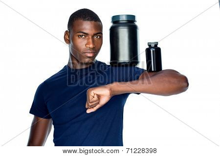 Portrait of fit young man holding bottles with supplements on his biceps