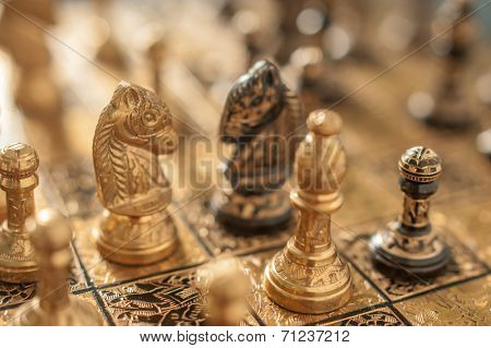 two horse on chessboard closeup