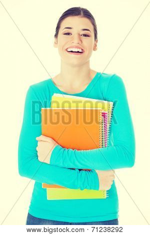 Beautiful young woman student with workbook. Isolated on white.
