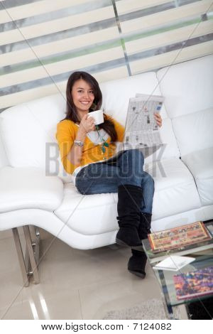 Woman With Coffee And The Newspaper