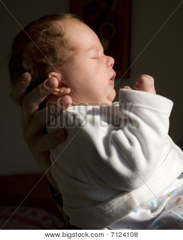 little boy in the hands of father