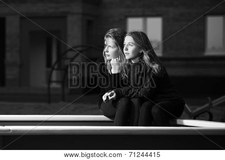 Two young school girls on the playground