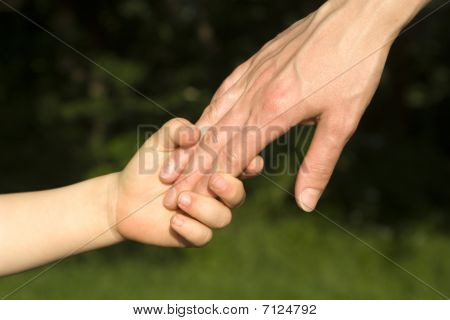 hand of mater and child