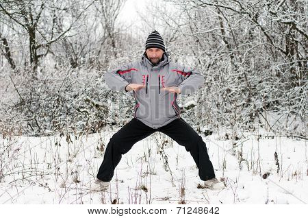 A Man Goes In For Sports In Winter Outdoors