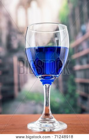 glass with blue liquor