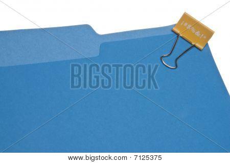 Expletive Paper clip On Blue File Folder.