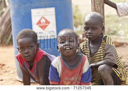 TORIT, SOUTH SUDAN-FEBRUARY 21 2013: Unidentified boys play outside in the village of Torit, South Sudan