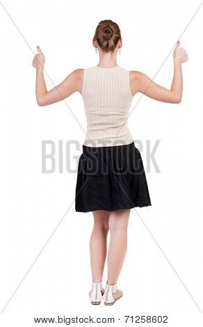 Back view of successful woman thumbs up. Rear view people collection. backside view of person. Isolated over white background. slender blonde in a dress shows hitchhiking
