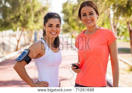 Happy Runners With Earbuds