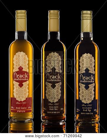 Three bottles of Mabrouka Authentic Arack on black background