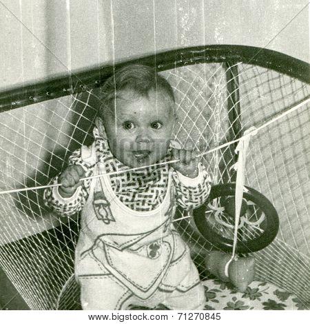Vintage photo of baby girl (early eighties)