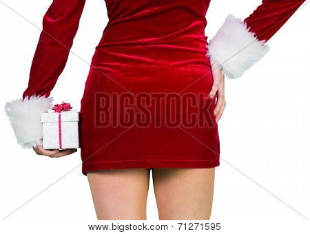 Sexy girl in santa outfit holding gift on white background