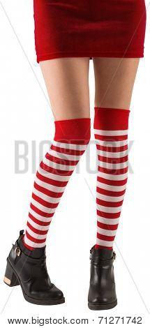 Santa girl wearing stripey socks on white background