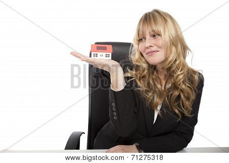 Corporate Woman With Miniature House