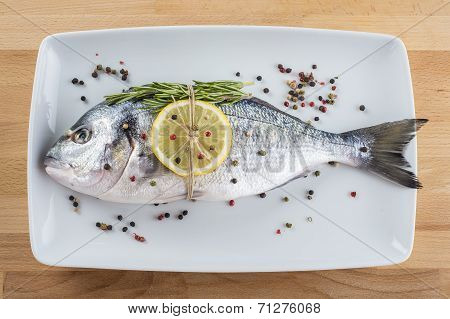 Gilt-head Sea Bream Fish With Spices On A Platter