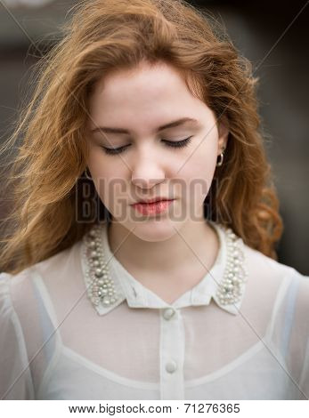 Beautiful Ginger Teenage Girl Looking Down