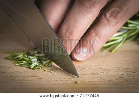 Chef Chopping A Rosemary Branch