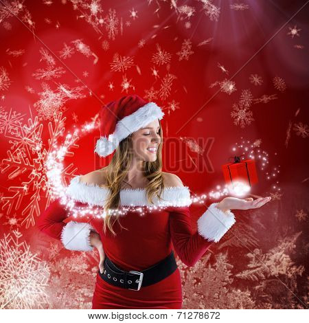 Sexy santa girl presenting with hand against red snow flake pattern design