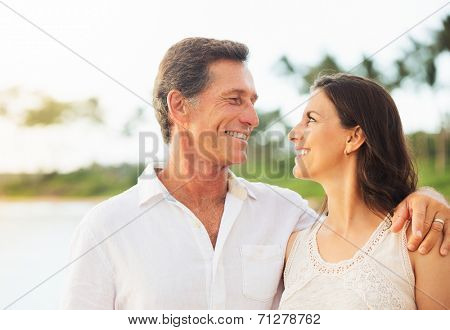 Mature Retired Couple Enjoying Tropical Sunset Beach Vacation