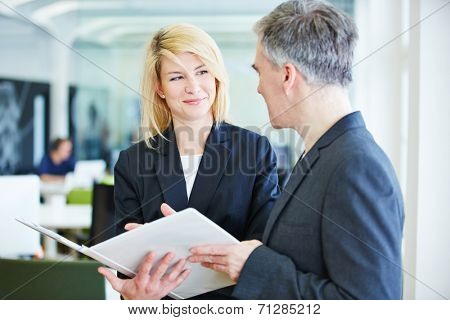 Negotiations in office lead to success for business man and woman