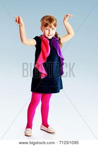 girl in a blue velvet dress held up his hands.