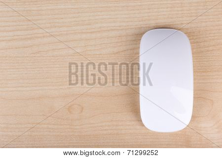 New modern wireless computer mouse on wooden table