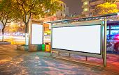 image of bus-shelter  - Blank billboard on bus stop at night - JPG