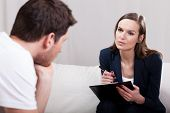stock photo of tell lies  - Professional experienced therapist conducting interview with patient - JPG