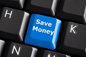 stock photo of save money  - save money for investment concept with a blue button on computer keyboard - JPG