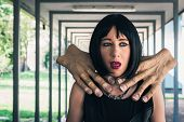 picture of choke  - Pretty dark goth girl choked by two huge hands - JPG
