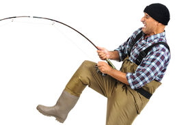 stock photo of rod  - Crazy faced fisherman with fishing rod isolated in white - JPG