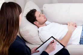 pic of therapist  - Young therapist working with patient on hypnosis  - JPG