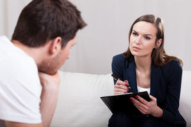 picture of conduction  - Professional experienced therapist conducting interview with patient - JPG