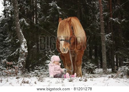 Small Girl Sitting In The Snow And Big Palomino Horse Standing Near