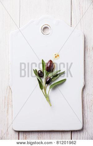 Olives With Sage Leaves On White Background