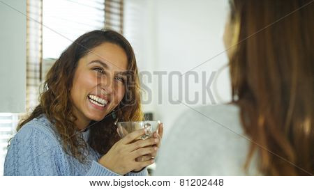 Attractive woman laughing with her friend