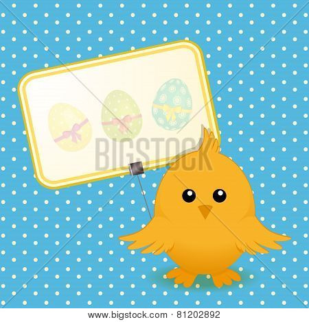 Easter Chick And Sign On Blue Background