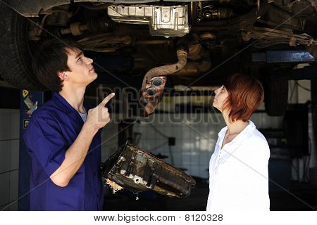 Car Mechanic Talking To Costumer