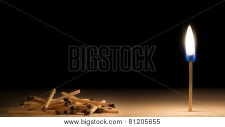 Pile Of Burnt Matches Laying Down In Front Of One Burning Match Metaphor