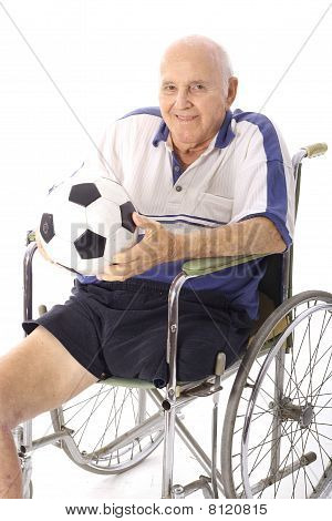 handicap elderly man with soccer ball vertical