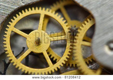 Background With Golden Metal Cogwheels Inside Clockwork