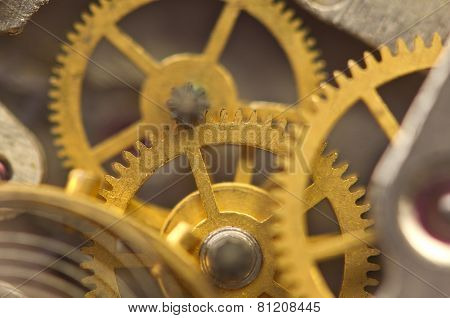 Background With Golden Metal Cogwheels Inside Clockwork.